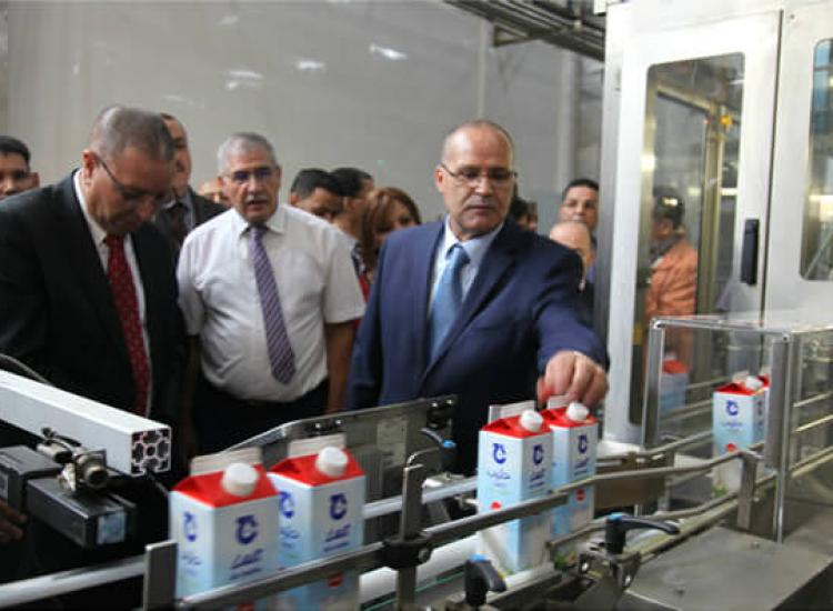 Algerian Minister with Giplait cartons made by Galdi's filling machine